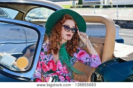 Vintage styled young lady at retro fashion and classic car show in Auckland, New Zealand