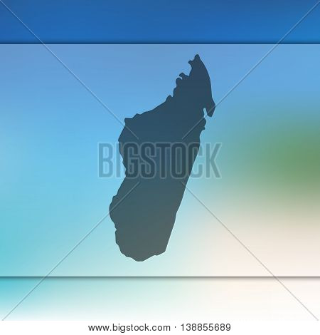 Madagascar map on blurred background. Blurred background with silhouette of Madagascar. Madagascar. Madagascar map.