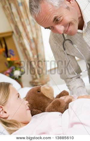 Doctor Talking To His Young Patient