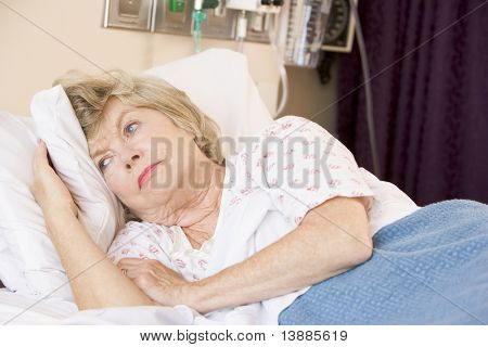 Senior Woman Lying In Hospital Bed