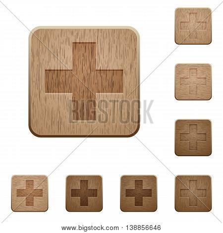Set of carved wooden plus sign buttons in 8 variations.