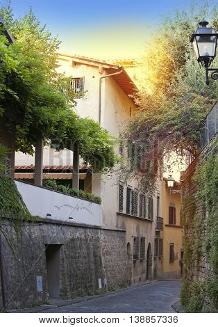 Italy. Florence. Narrow small street in a sunny day