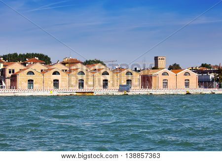 Venice Italy. Ancient industrial buildings on the bank of the channel.