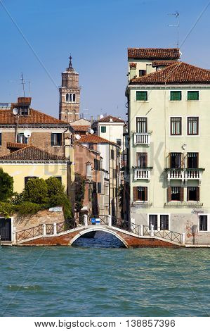 narrow street. Houses over the channel. Venice