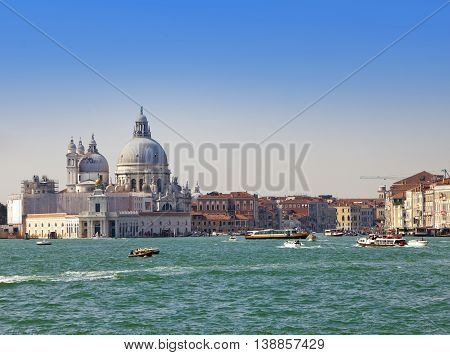 Grand Canal with boats and Basilica Santa Maria della Salute Venice Italy