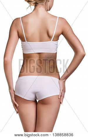 Young woman with big bruise on back isolated on white