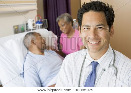Doctor Looking Cheerful In Hospital Room