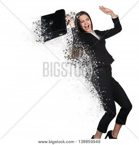 Young business woman decay into small pieces isolated on white.