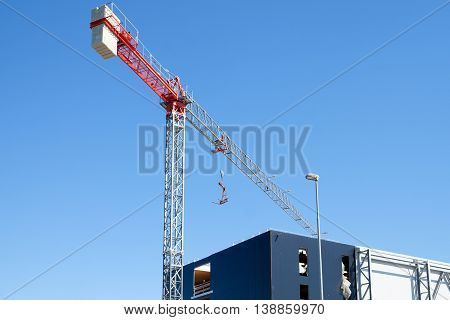 Modern crane in a construction site outdoors