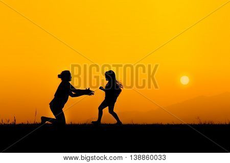 silhouette of a family and daughter running to mother on meadow she enjoyed in sunset