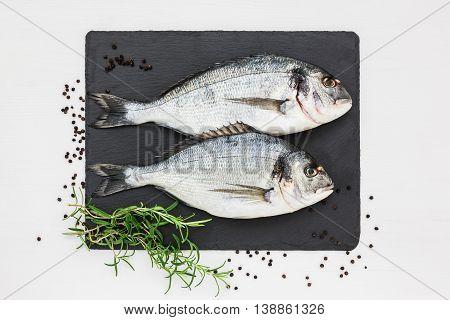 Fresh Dorado Fish On Slate Cutting Board.top View, Copy Space.