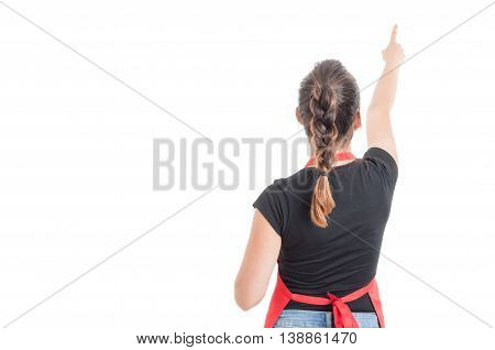 Rear View Of Supermarket Seller Pointing Finger Up