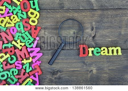 Dream word on wooden table