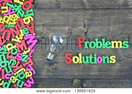 Problems and Solutions word on wooden table