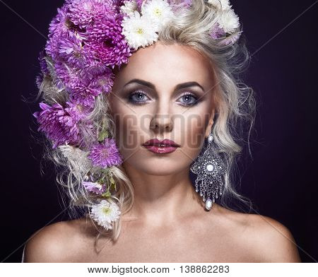 beauty foto of a woman with flowers in hair art fantasy portrait