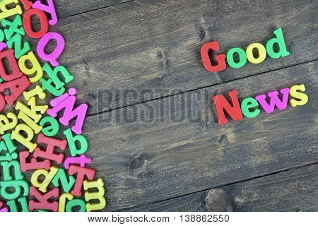 Good News word on wooden table