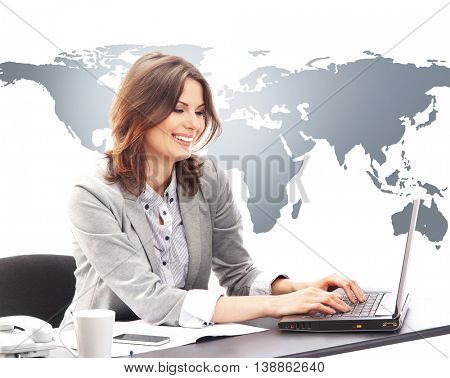 Beautiful business woman typing on laptop keyboard in office on world map background. Global business concept.