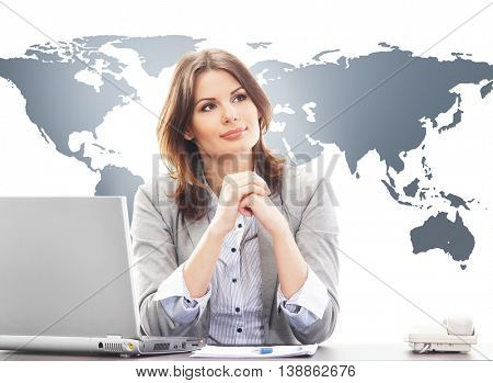 Beautiful business woman in office on world map background. Global business concept.