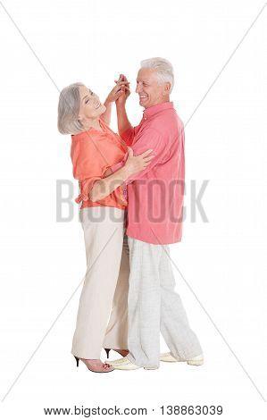 Elegant elderly couple dancing on white background