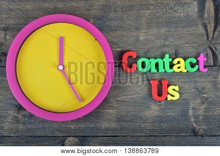 Contact us word on wooden table