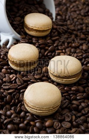 French coffee macaroons and coffee beans background