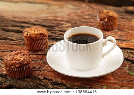 Chocolate cup cakes served with cup of hot coffee.