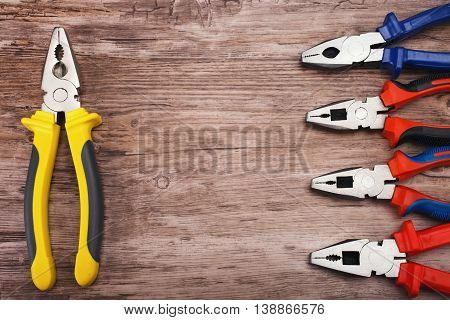 Locking pliers on wooden background, Prepare basic hand tools for work.