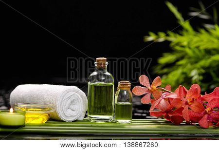 Spa set on long leaf with towel,branch orchid
