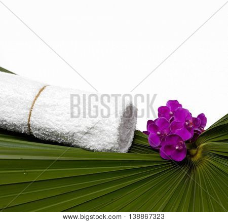 beautiful orchid, towel and palm leaf