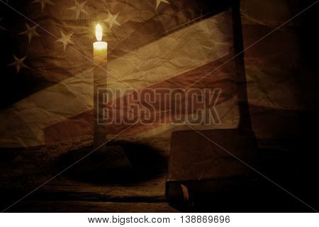 Old US flag and book. Closed book and burning candle. Power of knowledge is limitless. Past is a good teacher.