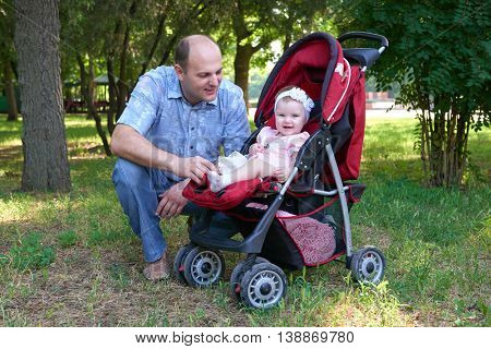 happy father with baby girl portrait in city park, summer season, child and parent