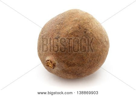 Organic dry Bahera or Beleric (Terminalia bellirica) seed. Isolated on white background. Macro close up. Top view.