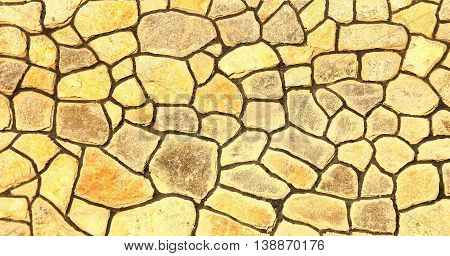 a nice of yellow stone wall background