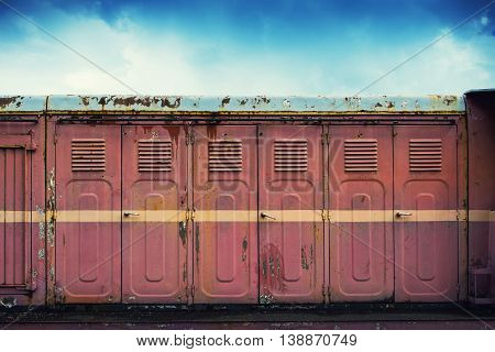 Row of dirty and rusty lockers standing outside. Grunge style.