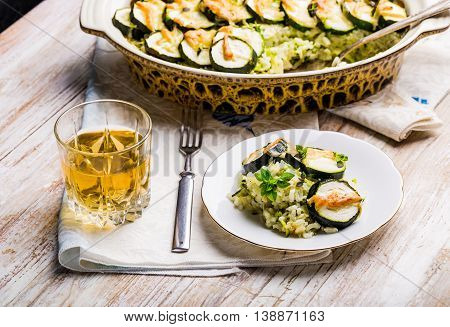 Casserole With Zucchini, Rice And Cheese Served With Fresh Basil