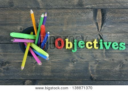 Objectives word on wooden table