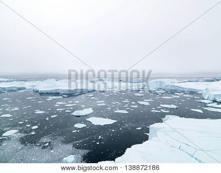 Icebergs on arctic ocean in Ilulissat icefjord Greenland