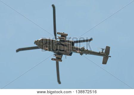 FARNBOROUGH, UK - JULY 14: Underside of a Boeing AH-64 Apache helicopter gunship arriving at Farnborough, UK on July 14, 2016