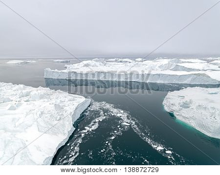 Icebergs on the arctic ocean at Ilulissat ice fiord in Greenland