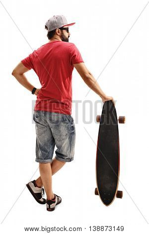 Full length rear view shot of a male skater leaning on a longboard isolated on white background