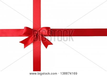 Red ribbon with bow-knot on white background