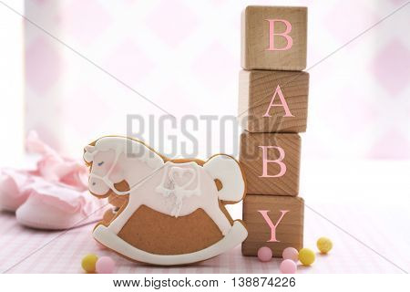 Wooden cubes with space for text and decorated cookie. Baby shower concept