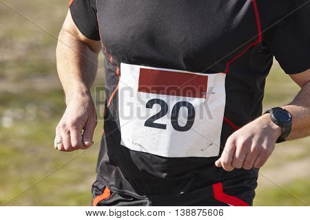 Men athletic runner on a cross country race. Outdoor circuit. Horizontal