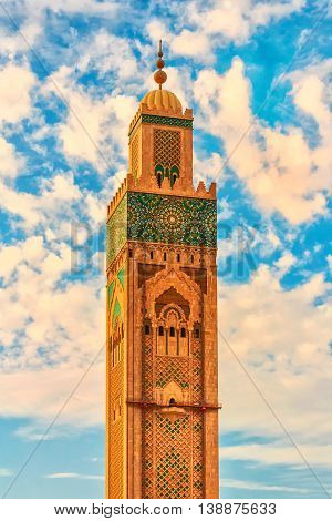 CASABLANCA, MOROCCO-OCTOBER 01, 2014: Hassan II Mosque Tower situated on the beach of Casablanca is the biggest mosque in Morocco and has the biggest minaret in the world.