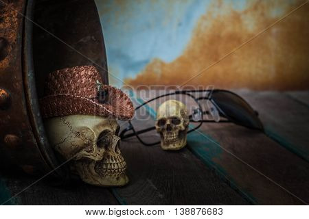 Skull cap on the water tank on the old wooden