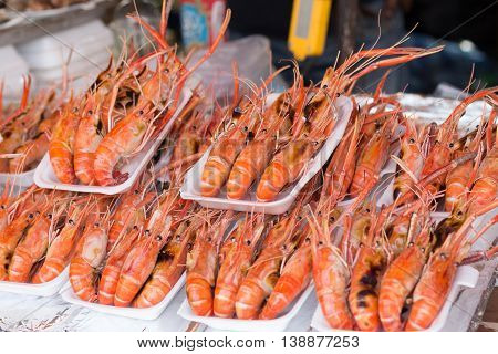 Grilled shrimp. grilled shrimp in foam box. Grilled big river prawn on foam box for sell in bangkok market.