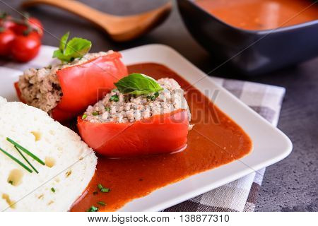Red pepper stuffed with rice, minced pork, garlic, basil in tomato sauce with steamed dumplings