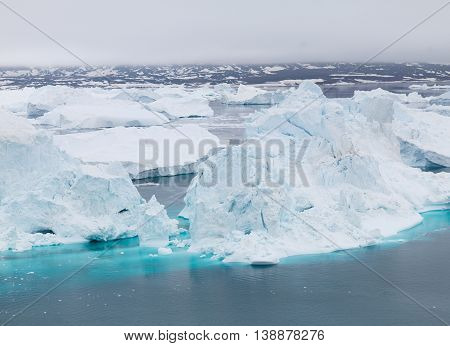 Icebergs on the arctic ocean, north pole in Greenland