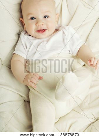 laughing cute baby on white