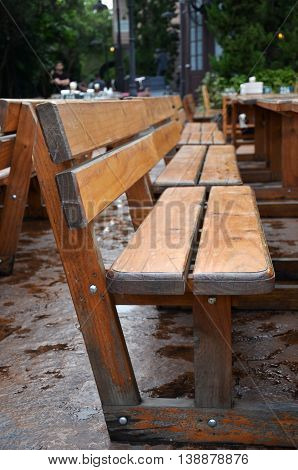 Wooden long bench in outdoor dinning area
